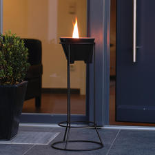 "Perched on the handmade 60cm (23 2⁄3"") high steel stand, the Wax Melter becomes a tall torch. Made of 8mm steel that is filigree and sturdy at the same time. Weather resistant thanks to the double powder coating. The 30cm (11 4⁄5"") diam. base keeps it steady."