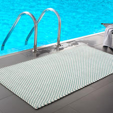 The turquoise/white mat in size 172 x 92cm (67.7″ x 36.2″) is great by the pool or in the spa area...