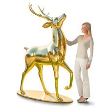 Gold-shimmering Deer - With a raised head and a proud stance, the impressive deer is the centre of all attention.