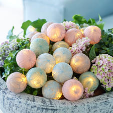 Bolette Mini Cotton Ball Lights - The delicate floral motifs of the string lights are created by finely spun cotton yarn.