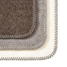 Available in the following colours: Wool white, taupe and grey.