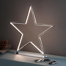 Shining Star - Cool, kitsch-free decorative piece: A chromed star with LED light contours.