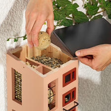 Simply take off the pent roof to easily refill each compartment.