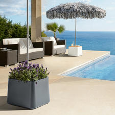 The stable parasol stand can be used as a decorative planter or optionally as a practical side table.