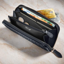 The same design and material as the bag, the matching wallet offers eight slots for credit cards as well as enough space in five separate compartments (one of which has a zip).