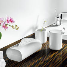 Exquisite eye-catcher – the white bath accessories by Alessi. Nothing disturbs the clear design.