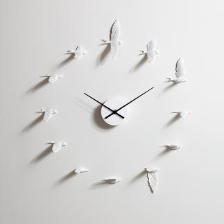 Swallow Clock Enchanting swallows tell the time. Image of lifelike flight movements.