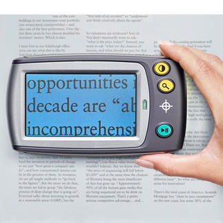 Digital Loupe with display Read even the small print with ease. Magnifies 5 to 28 times, or up to 250 times on your TV screen.