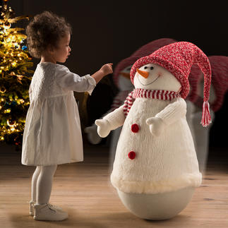Rocking Snowman This round-necked snowman will make you want to touch him over and over again.