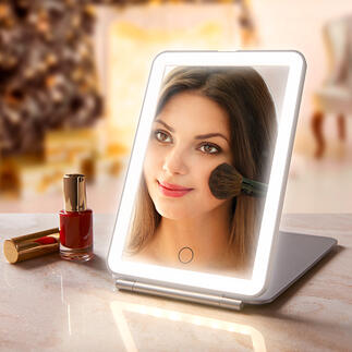 Folding Cosmetic Mirror Extra-large mirror surface. Optimum illumination. Elegant, flat design. For perfect make-up at home and when travelling.