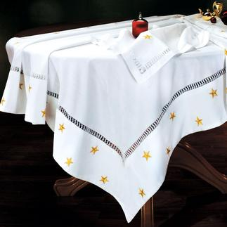 Christmas Tablecloth Fine table linen. Elegant, softly flowing fabric, elaborately adorned with glittering stars.