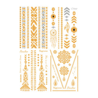 Temporary Tattoos Summer trend:  Decorative golden tattoos on gently bronzed skin - as easy as a sticker.
