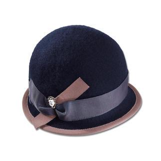 Ellen Paulssen Felt Hat As elegant as a hat. As easy as a cap. Soft wool felt. Crushable, resists wind and water.