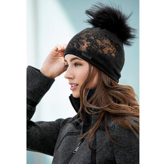 Norton Lace Bobble Hat Finn Raccoon bobble teamed with lace design and a metallic effect: The knitted hat becomes glamourous.