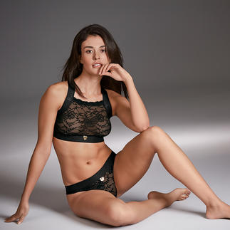 Moschino Underwear Lace Bustier and Panties The sports couture of lingerie: Lace underwear from the Italian trendy label Moschino.