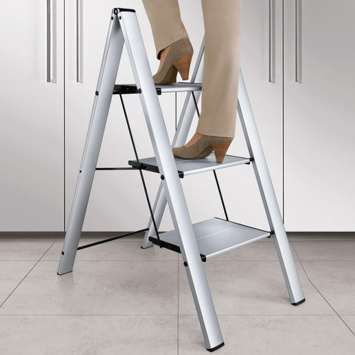 "Italian Aluminium Step Ladder Safer (and prettier): With extra deep steps. Yet collapsible to a thin 4cm (1.6"")."
