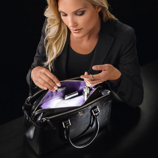SOI Handbag Light - The first automatic, energy-efficient handbag light.