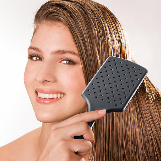 WetBrush® Paddle Brush Detangles your hair with ease, makes it easy to style and provides a soothing head massage.
