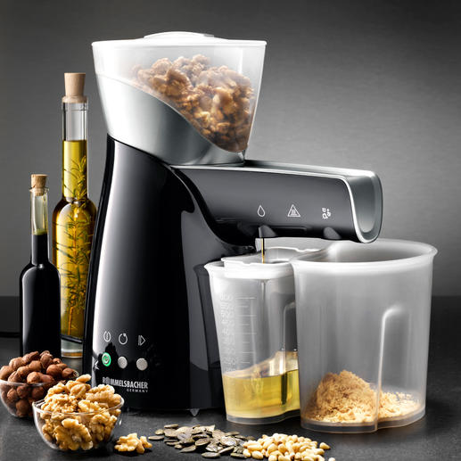 Electric Oil Press - Presses seeds, nuts and kernels purely by mechanical means. Without heat.
