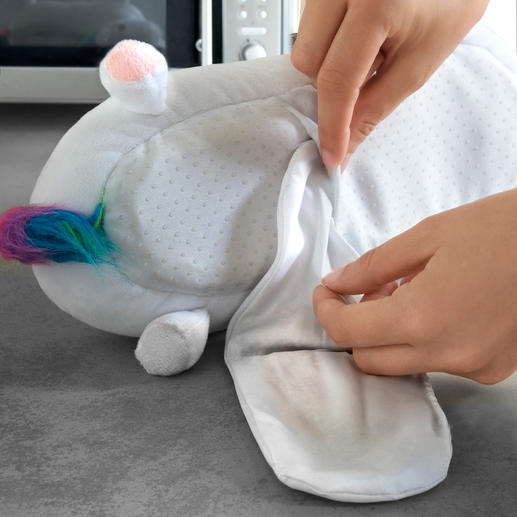 "The heat pad is easily placed in the sole of your new ""unicorn"" slippers."