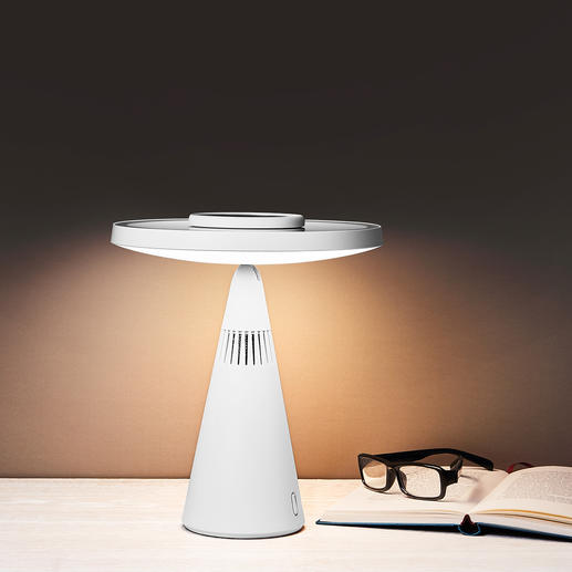 Easy to rotate 45 degrees up - and your cosmetic mirror becomes a designer table lamp.