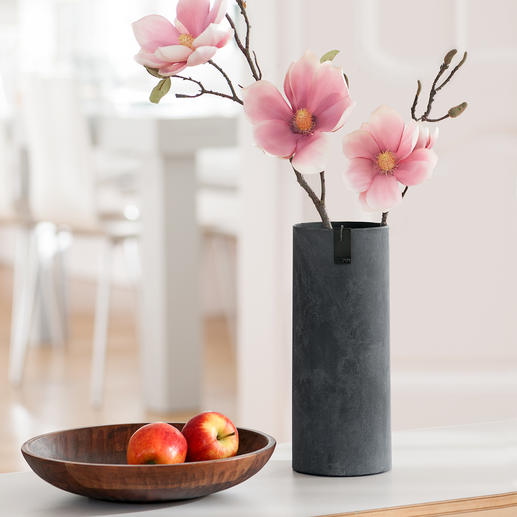 The slim vase is also ideal for long-stemmed flowers.