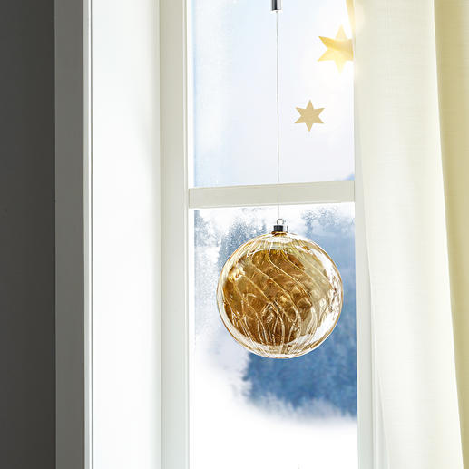 Decorative for hanging or freestanding. During the day the tinted glass glows softly like precious amber.