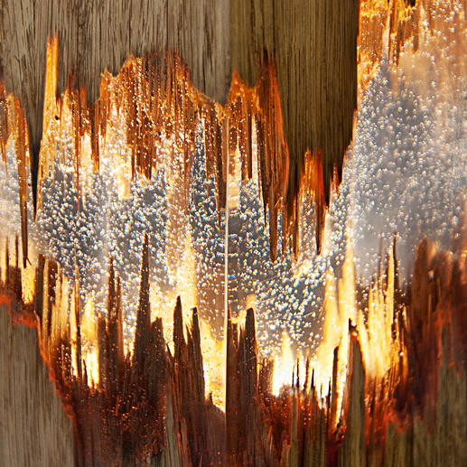 Transparent resin gives a clear view of the charming splintered structure of the wood.