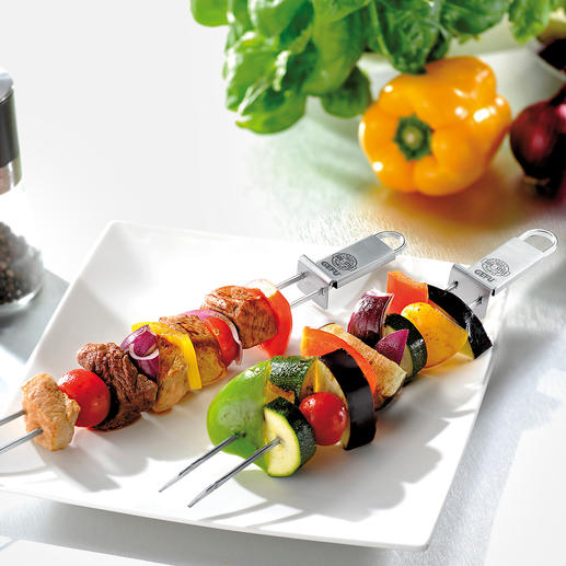 Double Grill Skewer with Scraper, Set of 2 Nothing slips or twists when being turned. And everything glides gently and cleanly from the skewer onto the plate.