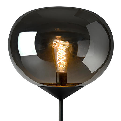 Turn on the light and – as if by magic – the glass globe becomes transparent and shows the glowing light bulb.