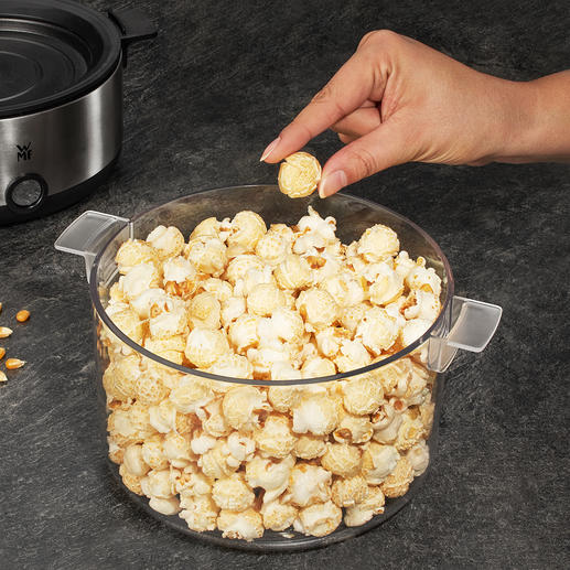 Simply turn the crystal-clear lid upside down to serve the popcorn in style.