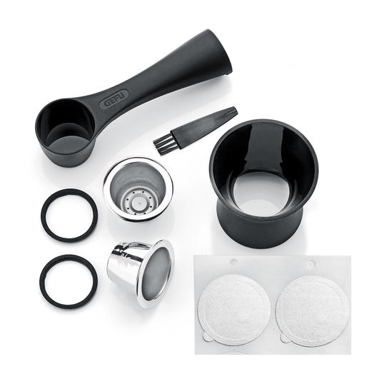 The 8-piece set contains 2 stainless steel capsules, coffee measuring spoon with tamper, 80 aroma stickers, 2 replacement sealing rings, and a cleaning brush.