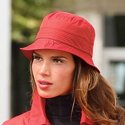 Knirps® Unisex Rain Hat Finally: A rain hat that always fits. Waterproof. Breathable. With seamless size adjustment.