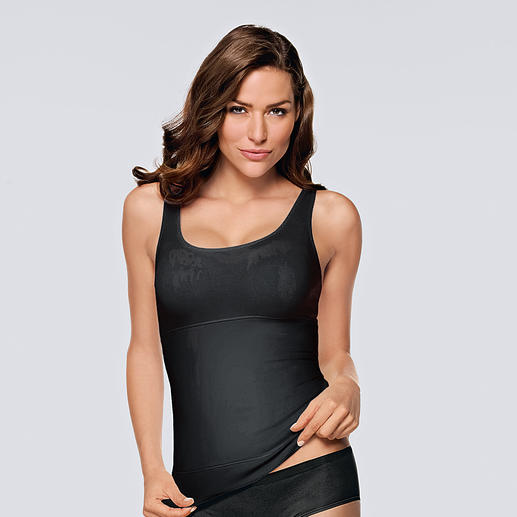 Triumph shaping top A flat tummy and full décolleté:Shaping in all the right places. Top by Triumph.