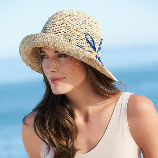 Ellen Paulssen Raffia Hat Finally, an airy straw hat that can be bent without breaking.
