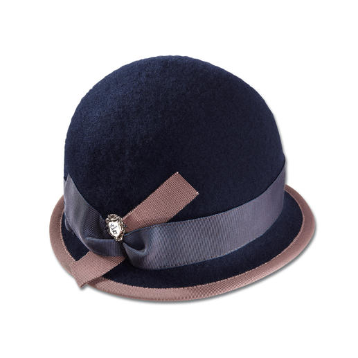 Ellen Paulssen Felt Hat As elegant as a hat. As easy as a cap. Soft wool felt. Crushable, resists wind and water.