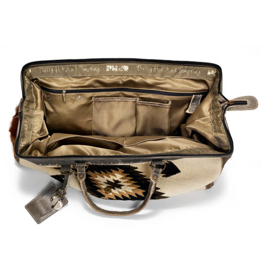 Kilim Travel Bag The weekender bag made of handmade kilim with buffalo and goat leather details. By Dutch ethnic label PH&T.