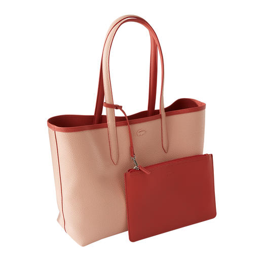 Lacoste Reversible Shopper One side typical piqué print, one side fine leather look. The robust reversible shopper in Rosé and Melba.
