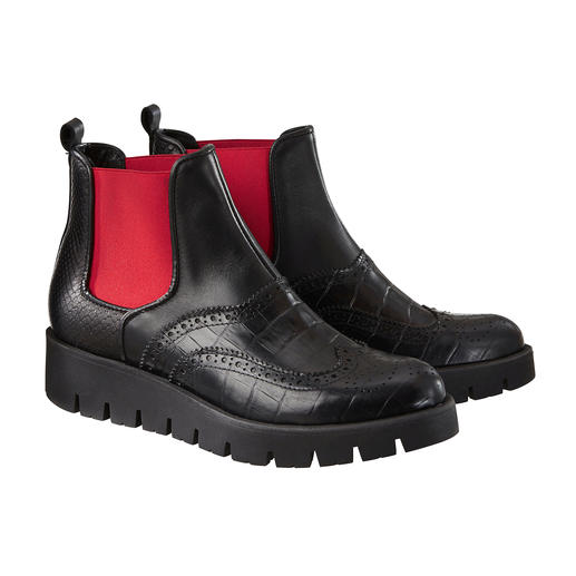 From fashion classic to winterproof street style star. From fashion classic to winterproof street style star. Extravagant makeover for the classic Chelsea boot.