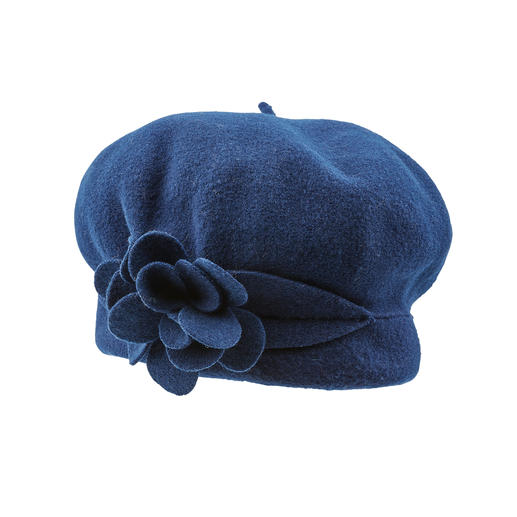 Laulhère Flower Beret Laulhère makes the only true 100% French beret. Handcrafted from pure merino wool. Fashionable flower detail.