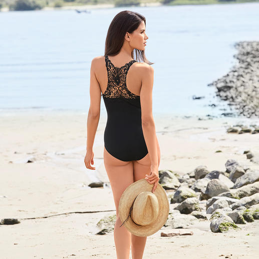 "Opera® Lace Swimsuit More seductive than most swimsuits. The ""little black swimsuit"" with lace back and décolleté lacing. By Opera®."