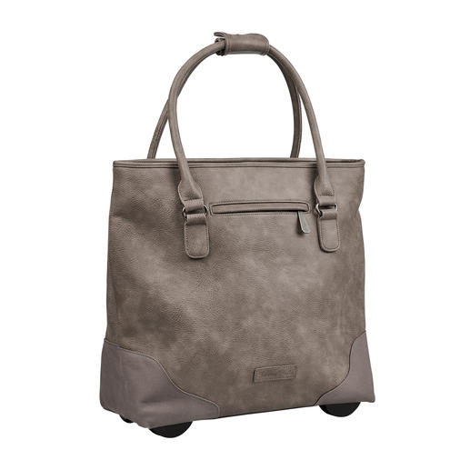 Always elegant. Ample capacity. Never too heavy. Always elegant. Ample capacity. Never too heavy. The XL tote bag with hidden trolley function.