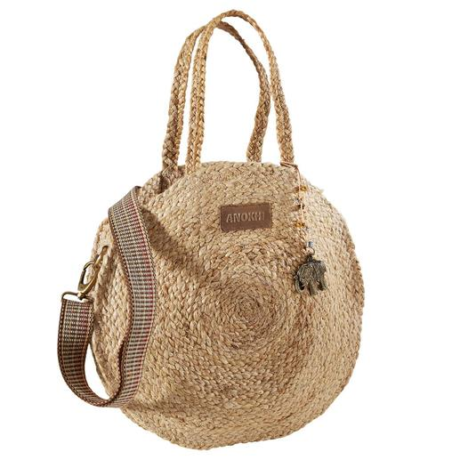 A fashionable alliance of round jute bag and striking bag strap. A fashionable alliance of round jute bag and striking bag strap. From the trendy label Anokhi, Munich.