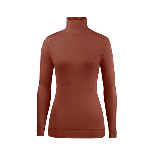 Key-piece layering roll-neck jumper: One that doesn't add any bulk despite the fashionable ribbed fabric and winter style. One that doesn't add any bulk despite the fashionable ribbed fabric and winter style. By SLY010, Berlin.