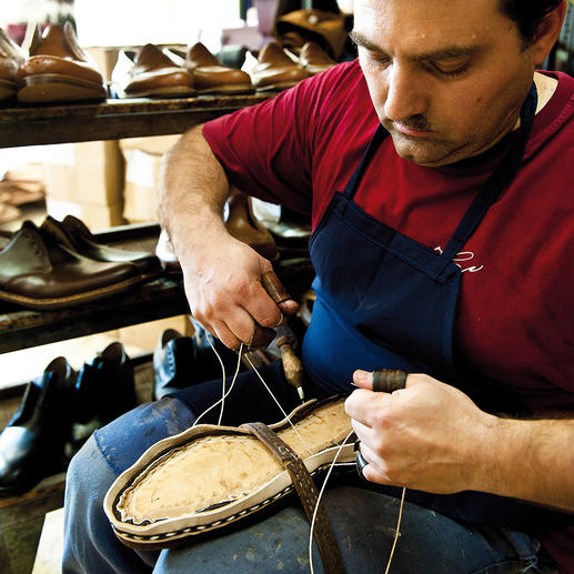 Leather welt, insole and leather upper are sewn together by hand.